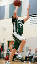 Kewaskum Youth Basketball player shooting a layup